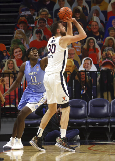 Huff, Hauser lead No. 9 Virginia past UNC, 60-48