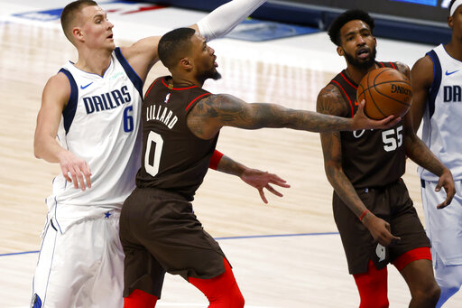 Lillard helps Trail Blazers top Doncic, Mavericks 121-118