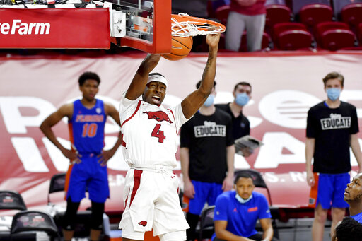 No. 24 Arkansas tops Florida 75-64 for 7th straight SEC win