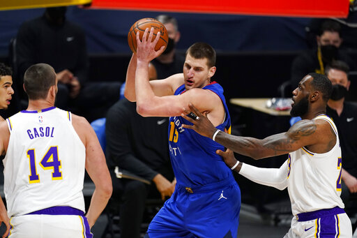 Jokic powers Nuggets by Lakers, Davis re-aggravates Achilles