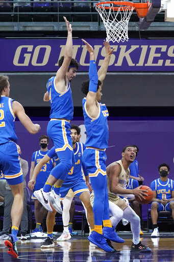 Juzang scores career-high 32, UCLA holds off Washington