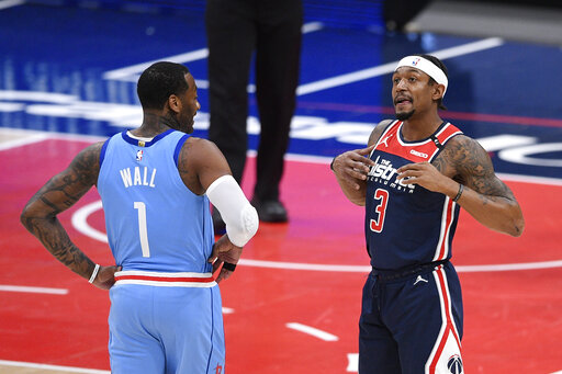 Beal outduels ex-teammate Wall, Wizards top Rockets 131-119