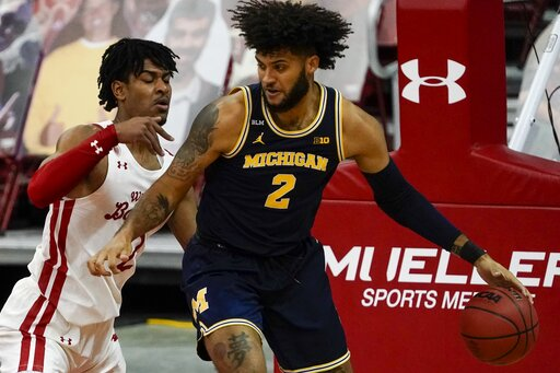 Back from layoff, No. 3 Michigan tops No. 21 Wisconsin 67-59
