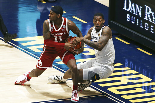 Oklahoma holds off West Virginia in double OT
