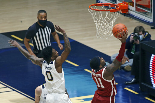 Reaves lifts No. 12 Oklahoma over No. 14 WVU 91-90 in 2OT