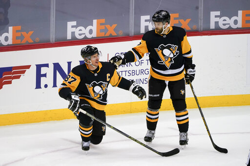 Rust scores twice, Penguins roll past rusty Capitals 6-3